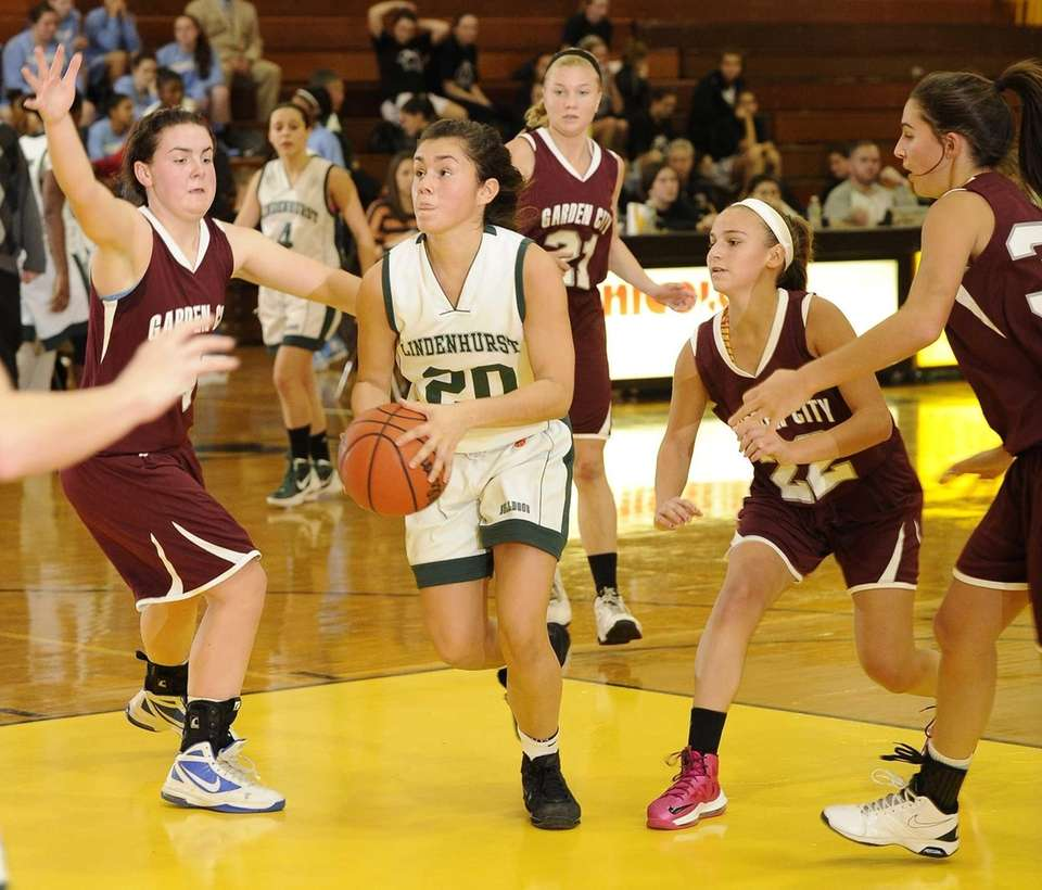 Lindenhurst's Araina Irizarry drives through the paint past
