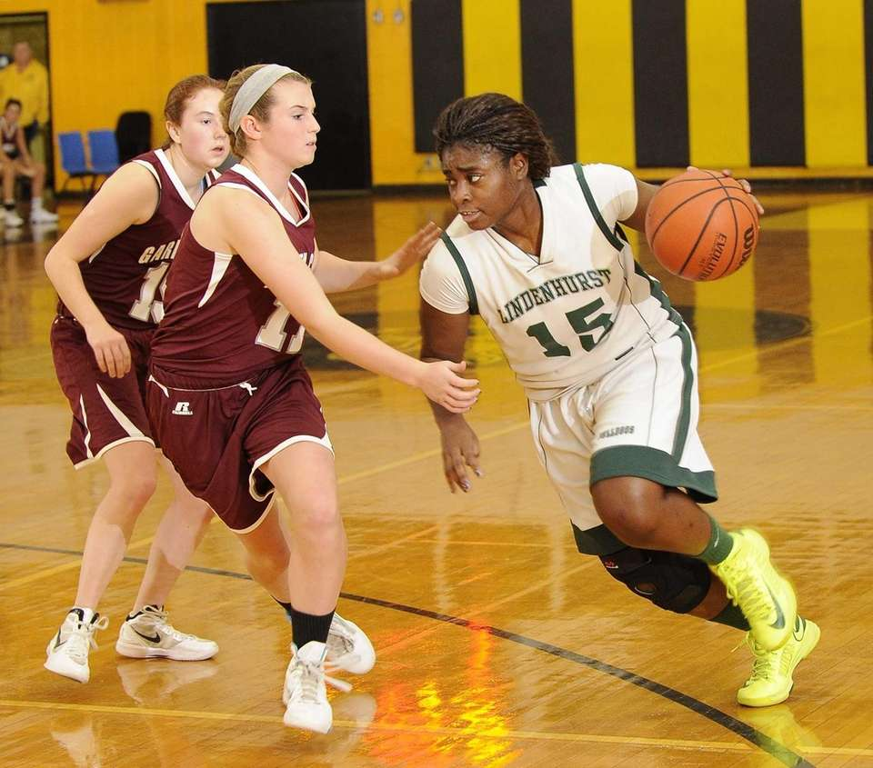 Lindenhurst's Valerie Oyakhilome is guarded by Garden City's