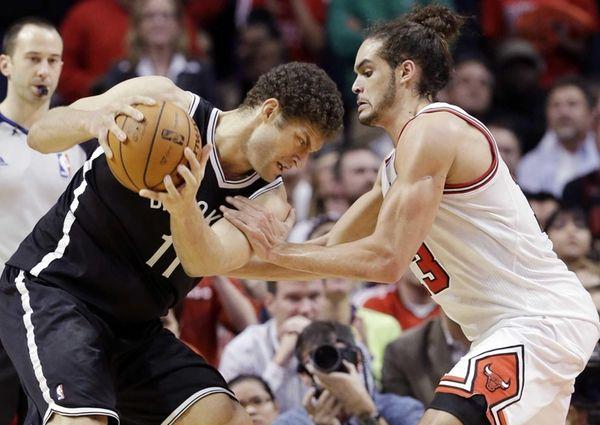 Chicago Bulls center Joakim Noah, right, guards Brook