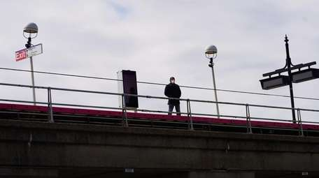 One man waits on the train platform at