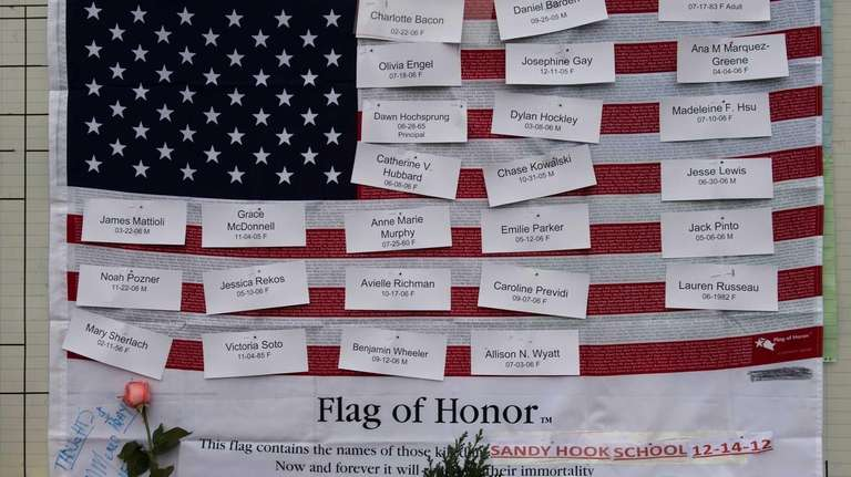 Names of shooting victims are displayed on a