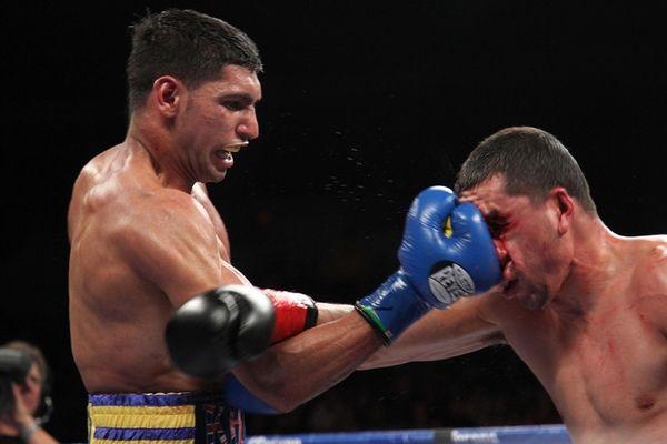 Amir Khan lets off right jab against Carlos