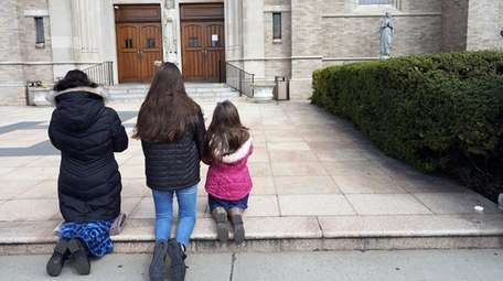 Parishioners, Tracy, left, and her daughters Bernadette, 18,