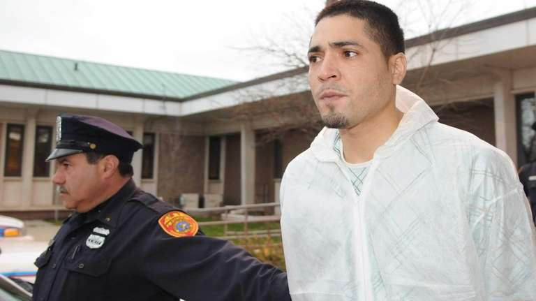 Luis Flores, 31, of Brentwood, is led from