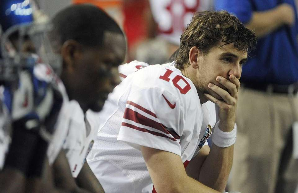 New York Giants quarterback Eli Manning sits on