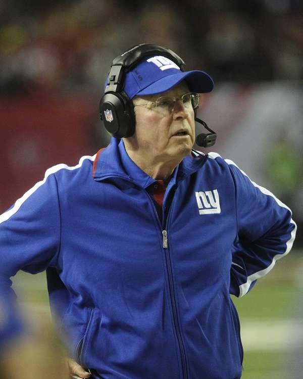 Tom Coughlin watches play during the second half.