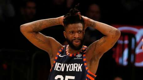 Reggie Bullock #25 of the Knicks reacts during