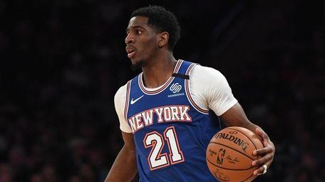 Knicks guard Damyean Dotson controls the ball against