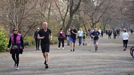 Runners in Manhattan's Central Park on Friday. Gov.