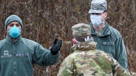 Members of the U.S. Air Guard talk to