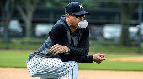 Yankees manager Aaron Boone watches drills during spring