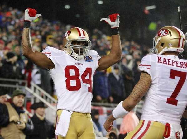 San Francisco 49ers wide receiver Randy Moss celebrates