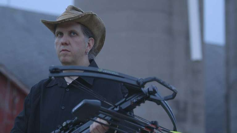 Shawn Beatty with cross bow in Discovery Channel's