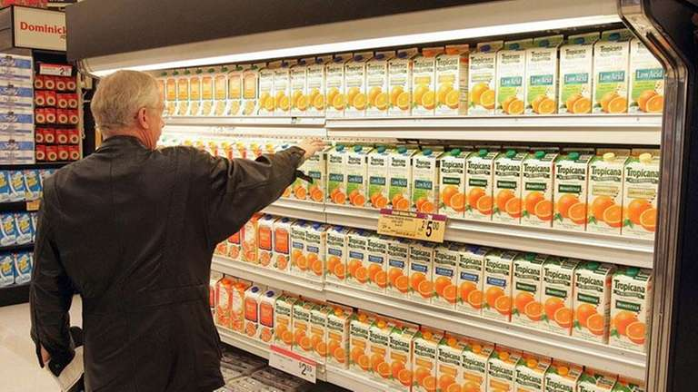 A man shops for Tropicana juices in a