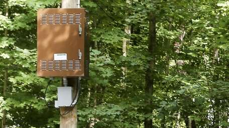 Cellphone equipment is mounted on poles across Oyster