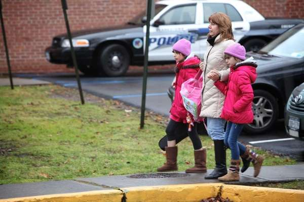 A parent walking her girls to Upper Nyack
