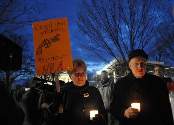 Gun control supporters take part in a candlelight