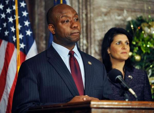 Rep. Tim Scott, left, speaks during a news