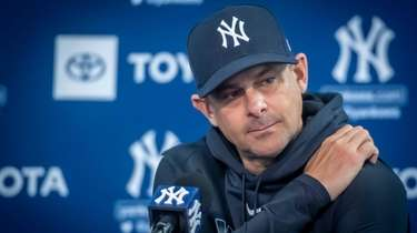 Yankees manager Aaron Boone speaks to reporters during
