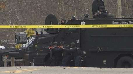 Suffolk police tactical officers at the scene Wednesday