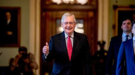 Senate Majority Leader Mitch McConnell of Ky. gives