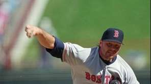 Boston Red Sox pitcher Roger Clemens throws during