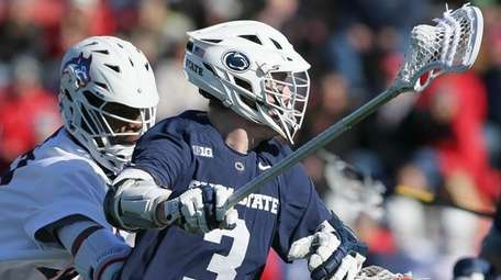 Penn State's Mac O'Keefe tries to get around