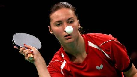 Maria Dolgikh of Russia plays table tennis at