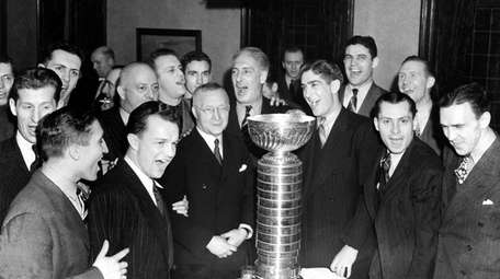 Members of the Rangers pose with the Stanley