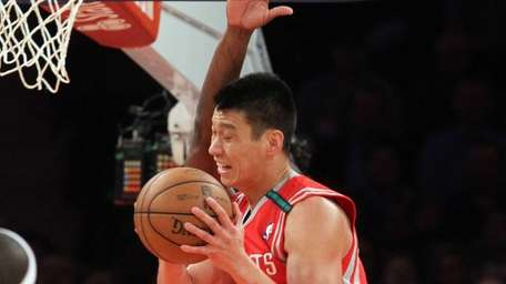 Jeremy Lin of the Houston Rockets tries to