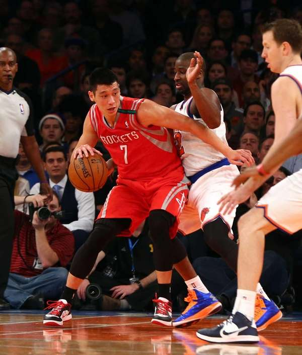 Jeremy Lin of the Houston Rockets controls the