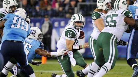 Tim Tebow is sacked by Zach Brown of