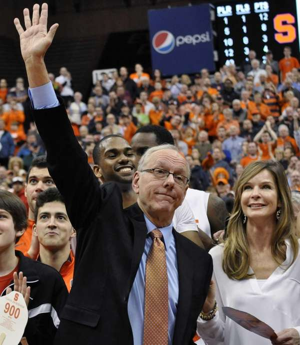 Syracuse coach Jim Boeheim, standing next to his