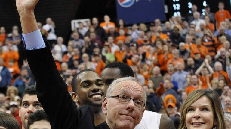 Syracuse coach Jim Boeheim, standing next to his