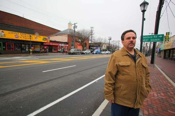 Pat Nicolosi stands at the 2.9-acre property on