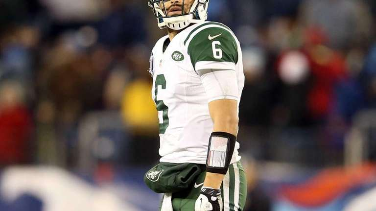 Mark Sanchez walks off the field after a