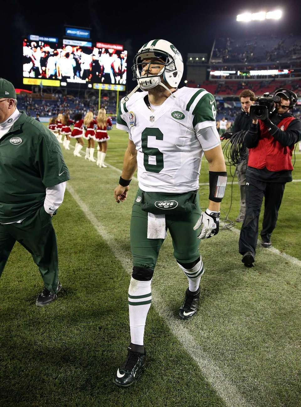 Mark Sanchez walks off of the field following