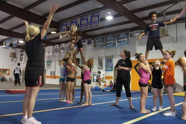 Coach Alisha Dunlap trains young cheer leaders in