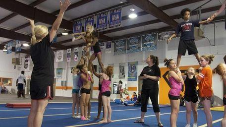 Coach Alisha Dunlap trains young cheer leaders in