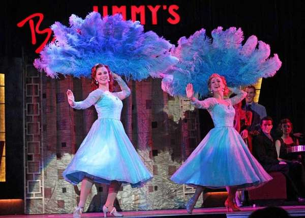 "The cast of ""Irving Berlin's White Christmas"" brings"