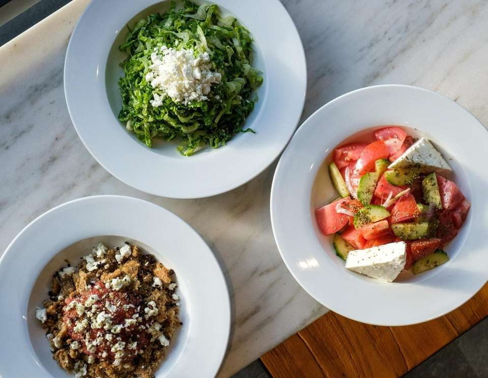A trio of traditional Greek salads at Herb