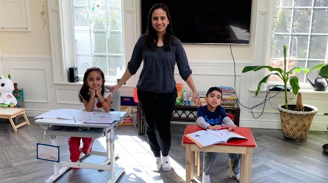 Natasha Ramjit, 38, of Dix Hills, holds