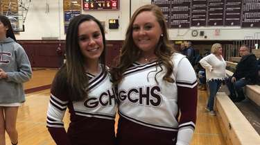 Garden City High School cheerleaders Lauren Nolan, left,