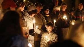 Mourners gather for a candlelight vigil at Ram's