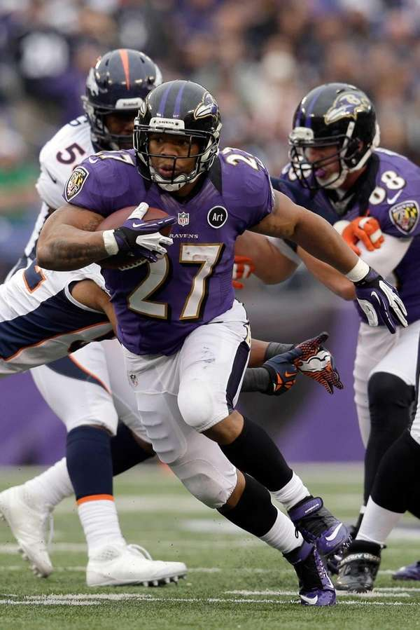 Baltimore Ravens running back Ray Rice carries the