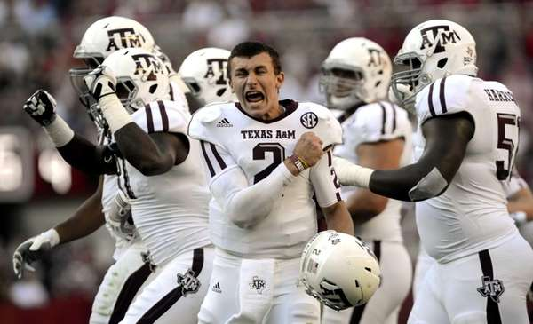 Texas A&M quarterback Johnny Manziel (2) celebrates after