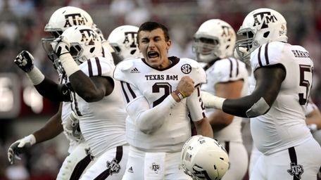Texas A&M quarterback Johnny Manziel (2) celebrates after