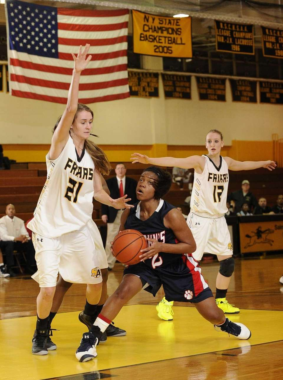 St. John the Baptist's Lauren Williams is guarded