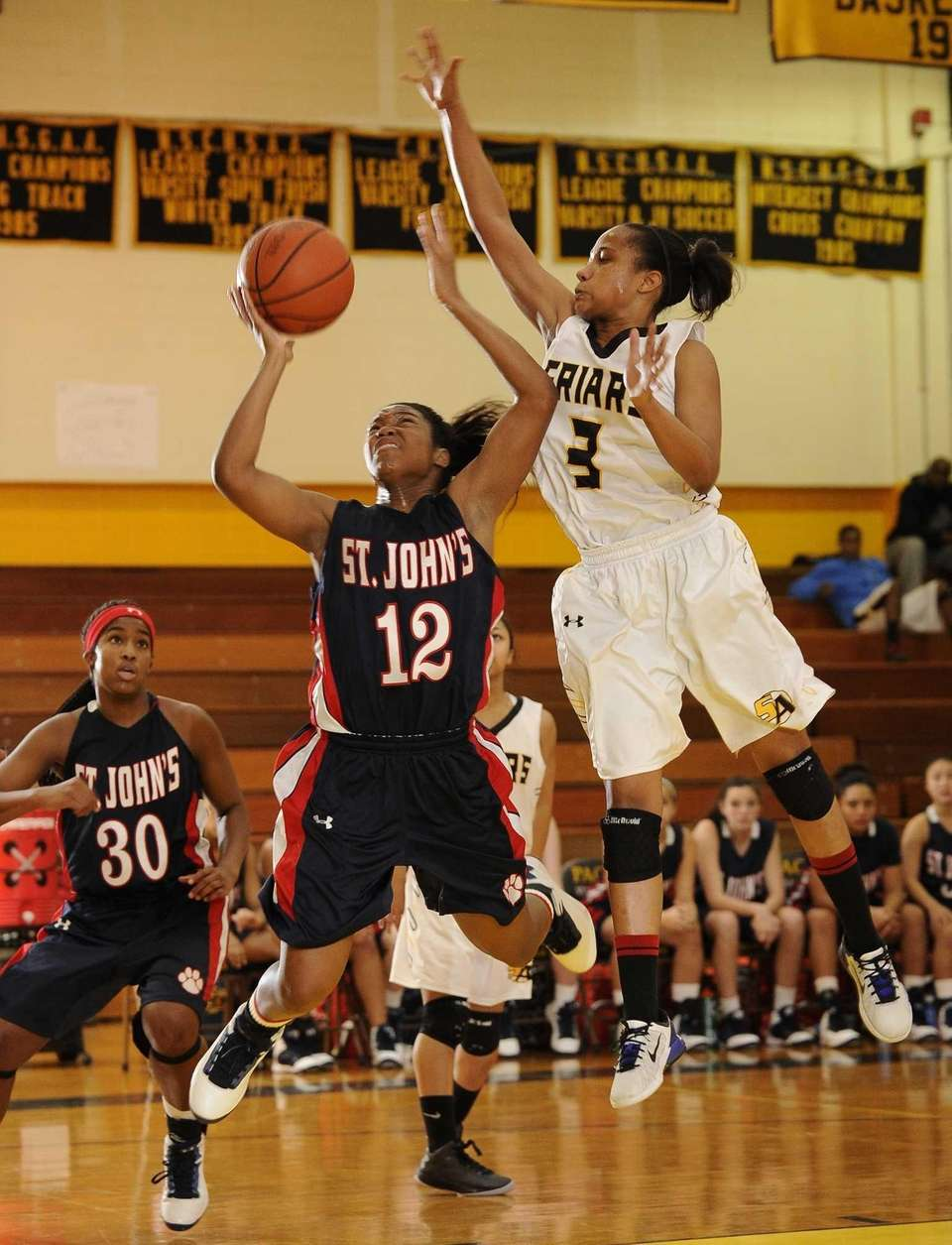 St. Anthony's Charise Wilson goes up for the