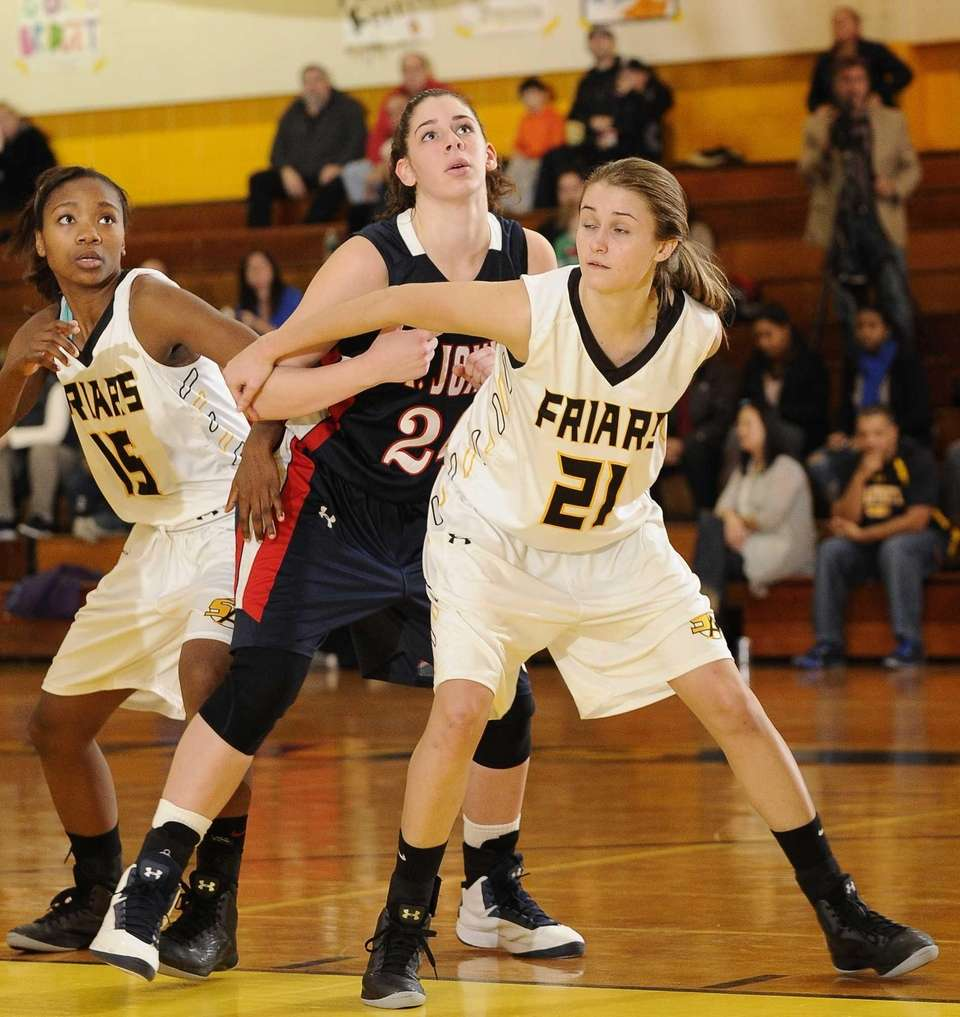 St. Anthony's Johanna Impellizeri boxes out St. John